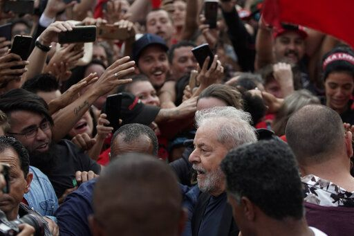 Brazil's former President Luiz Inacio Lula da Silva, bottom, is surrounded by supporters as he exits the Federal Police headquarters where he was imprisoned on corruption charges in Curitiba, Brazil, Friday, Nov. 8, 2019. Da Silva walked out of a Curitiba prison Friday, less than a day after the Supreme Court ruled that a person can be imprisoned only after all the appeals have been exhausted.
