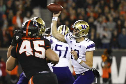Washington quarterback Jacob Eason (10) throws a pass during the first half of the team's NCAA college football game against Oregon State in Corvallis, Ore., Friday, Nov. 8, 2019.