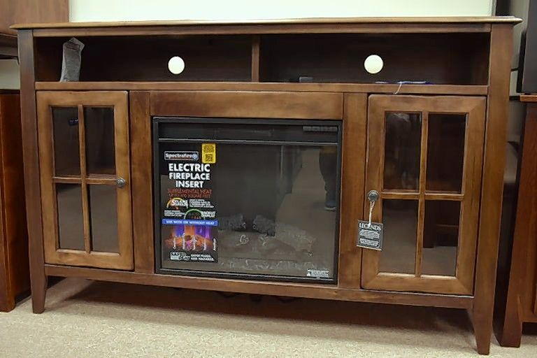 Amish Furniture makes a 60-inch fireplace TV cabinet with an electric fireplace insert.