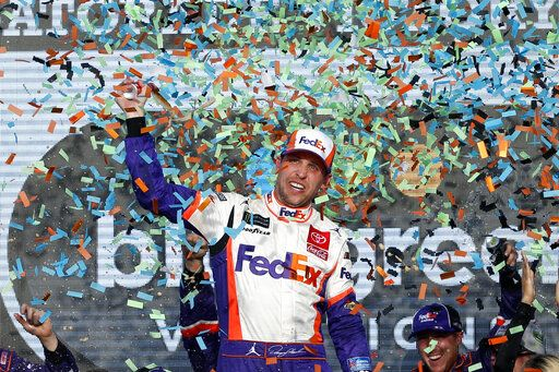 Denny Hamlin celebrates in Victory Lane after winning the NASCAR Cup Series auto race Sunday, Nov. 10, 2019, in Avondale, Ariz.