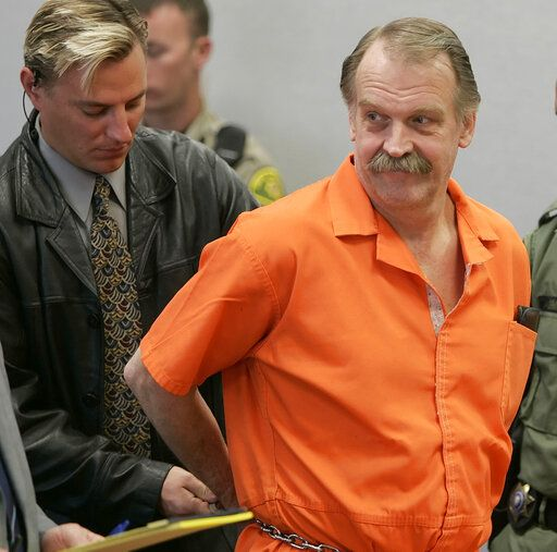 "FILE - In this Oct. 6, 2005 file photo, convicted murderer and death row inmate Ron Lafferty is handcuffed after his court hearing in a courtroom in Provo, Utah. Utah prison officials said Monday, Nov. 11, 2019, that Lafferty, a death-row inmate whose double-murder case was featured in the book ""Under the Banner of Heaven"" and who was nearing an execution by firing squad, has died of natural causes."