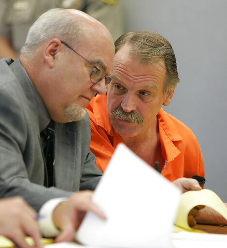 "FILE - In this Oct. 6, 2005, file photo, Ron Lafferty, right, confers with his attorney Bill Morrison at his court hearing in the 4th District Courtroom of Judge Anthony Schofield in Provo, Utah. Utah prison officials said Monday, Nov. 11, 2019, that Lafferty, a death-row inmate whose double-murder case was featured in the book ""Under the Banner of Heaven"" and who was nearing an execution by firing squad, has died of natural causes."