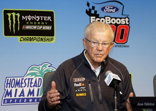 FILE - In this Nov. 16, 2018, file photo, Joe Gibbs, owner of Joe Gibbs Racing, speaks during a news conference for a NASCAR Cup series auto race at the Homestead-Miami Speedway in Homestead, Fla. Gibbs is a Hall of Fame NFL coach with three Super Bowl titles yet still changed course in his early 50s to wade into NASCAR and see if he could not build a second career and a family business.