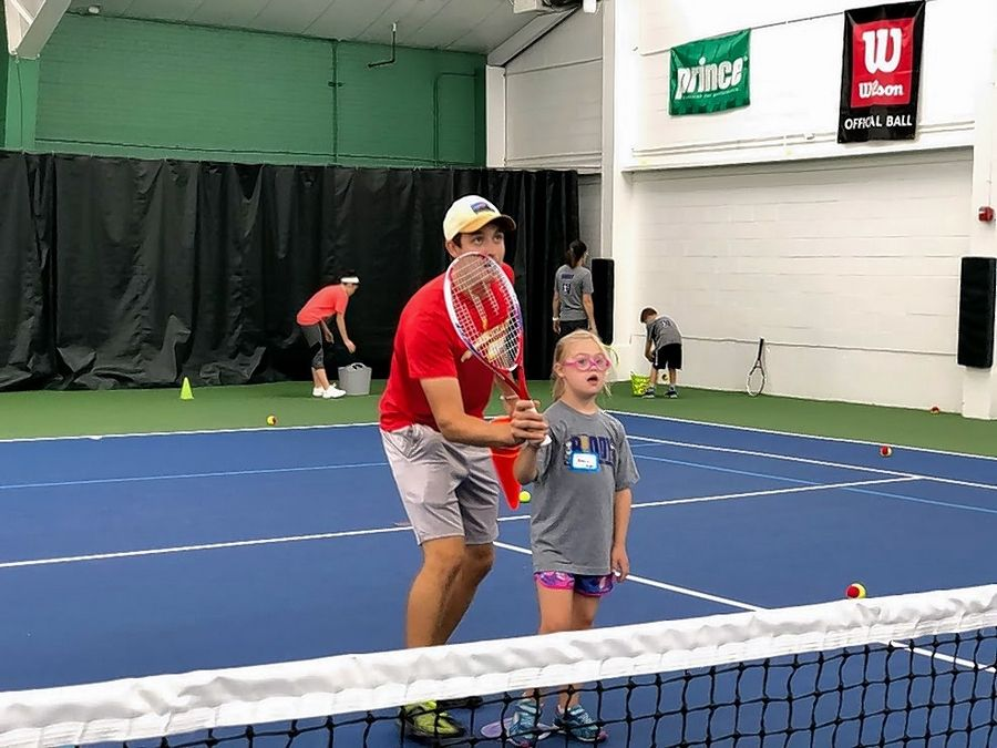 Coach Chris Wilkins, an assistant tennis professional at Heritage Tennis Club, works on basics with Annie Osterhues of Arlington Heights.