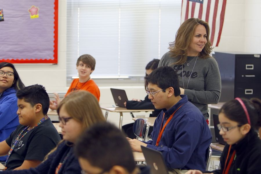 Seventh grade gifted class teacher Amy Kelly works with her students at Kimball Middle School in Elgin. Elgin Area School District U-46's new equity plan aims to close achievement gaps, including remedying underrepresentation of students from diverse backgrounds in programs, such as gifted, honors, academies and Advanced Placement courses.