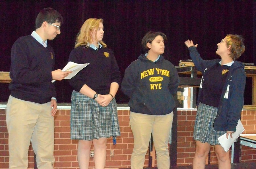 "Aurora Central Catholic High School will stage ""Rosencrantz and Guildenstern are Dead"" Nov. 15-16. Rehearsing, from left, are John Alcade, Aurora; Lauren Nelson, Batavia; Eve Tamez, North Aurora; and Gabby Selenis, Maple Park."