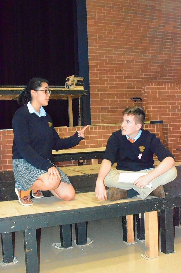 Dali Torres of Aurora and Andrew Mahon of Montgomery rehearse for Aurora Central Catholic High School's production of two Shakespeare-based plays.