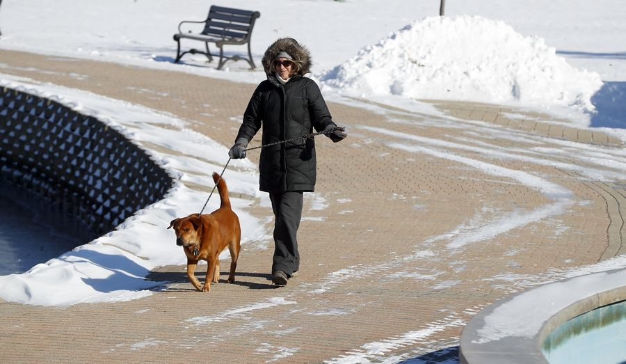 """We walk along here, rain, shine, hot or cold, every day,"" Candy Tumidalsky of West Chicago said Tuesday as she walks her sister's dog Bo along the Batavia Riverwalk."