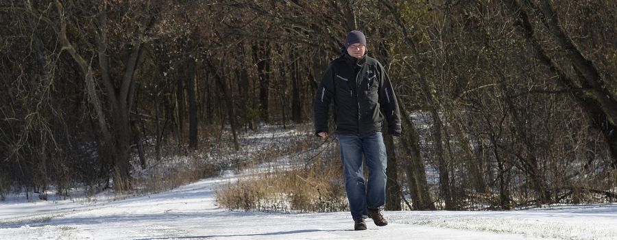 Charley Mitas enjoys a lunch hour walk in 18-degree weather at Deer Grove East Forest Preserve in Palatine on Tuesday.