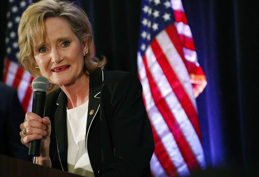 FILE - In this Nov. 27, 2018 file photo, Republican U.S. Sen. Cindy Hyde-Smith speaks to her supporters as she celebrates her runoff win over Democrat Mike Espy in Jackson, Miss. On Tuesday, Nov. 12, 2019, Espy announced another run for U.S. Senate, setting up a 2020 rematch with Hyde-Smith.