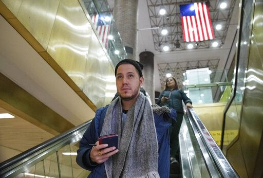 Martín Batalla Vidal takes an escalator into the Port Authority Bus Terminal in New York to take a bus to Washington, Monday, Nov. 11, 2019. Vidal is a lead plaintiff in one of the cases to preserve the Obama-era program known as Deferred Action for Childhood Arrivals and has seen his name splashed in legal documents since 2016, when he first sued in New York. His case will be heard at the Supreme Court beginning Tuesday.