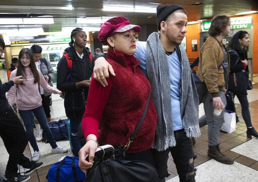 Luz Aurora Vidal and her son, Martín Batalla Vidal, line up to take a bus to Washington, Monday, Nov. 11, 2019, in New York. Martin Batalia Vidal is a lead plaintiff in one of the cases to preserve the Obama-era program known as Deferred Action for Childhood Arrivals and has seen his name splashed in legal documents since 2016, when he first sued in New York. His case will be heard at the Supreme Court beginning Tuesday.