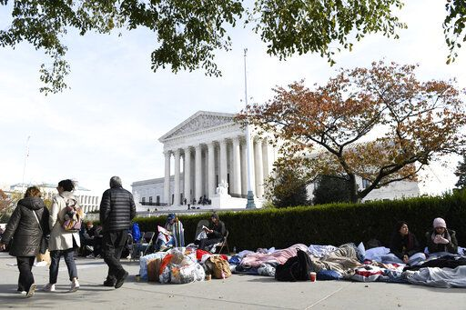 People wait in line outside the Supreme Court in Washington, Monday, Nov. 11, 2019, to be able to attend oral arguments in the case of President Trump's decision to end the Obama-era, Deferred Action for Childhood Arrivals program (DACA).