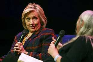 US former Secretary of State Hillary Clinton, left, talks to Classicist Mary Beard, at the Southbank Centre in London during the launch of Gutsy Women: Favorite Stories of Courage and Resilience, a book by Chelsea and Hillary Clinton, in London, Sunday, Nov. 10, 2019. (Aaron Chown/PA via AP)
