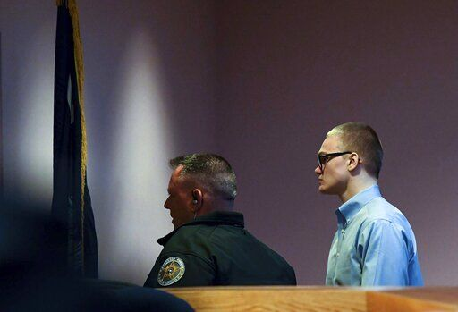 Jesse Osborne is escorted by Anderson County Sheriff Deputies as he leaves the courtroom, at the end of a special hearing before a judge, who will decide the 17-year-old's sentence, Tuesday, Nov. 12, 2019, in Anderson, S.C. Osborne pleaded guilty last year to two counts of murder for killing the boy at Townville Elementary School and shooting his father three times in the head so he could steal a pickup truck to get to his old school in September 2016. (Ken Ruinard/The Independent-Mail via AP)