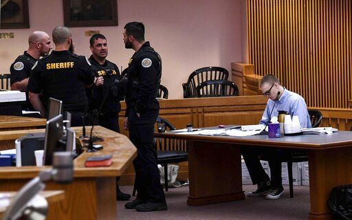 Jesse Osborne, right, waits for the afternoon session to begin during a special hearing before a judge, who will decide the 17-year-old's sentence, Tuesday, Nov. 12, 2019, in Anderson, S.C. Osborne pleaded guilty last year to two counts of murder for killing the boy at Townville Elementary School and shooting his father three times in the head so he could steal a pickup truck to get to his old school in September 2016. (Ken Ruinard/The Independent-Mail via AP)