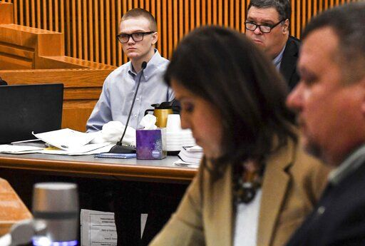 Jesse Osborne, left, watches during a special hearing before a judge, who will decide the 17-year-old's sentence, Tuesday, Nov. 12, 2019, in Anderson, S.C. Osborne pleaded guilty last year to two counts of murder for killing the boy at Townville Elementary School and shooting his father three times in the head so he could steal a pickup truck to get to his old school in September 2016. (Ken Ruinard/The Independent-Mail via AP)