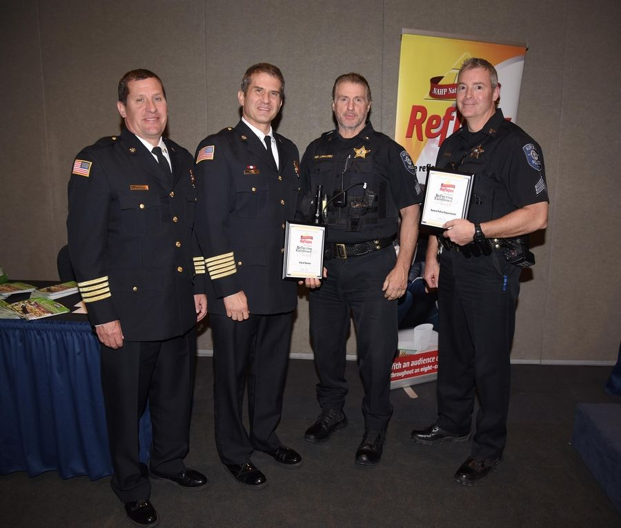 Aurora Police and Fire Department members show their awards at the 8th Annual Reflejos Reflecting Excellence Awards at the Stonegate Conference and Banquet Centre in Hoffman Estates Wednesday.