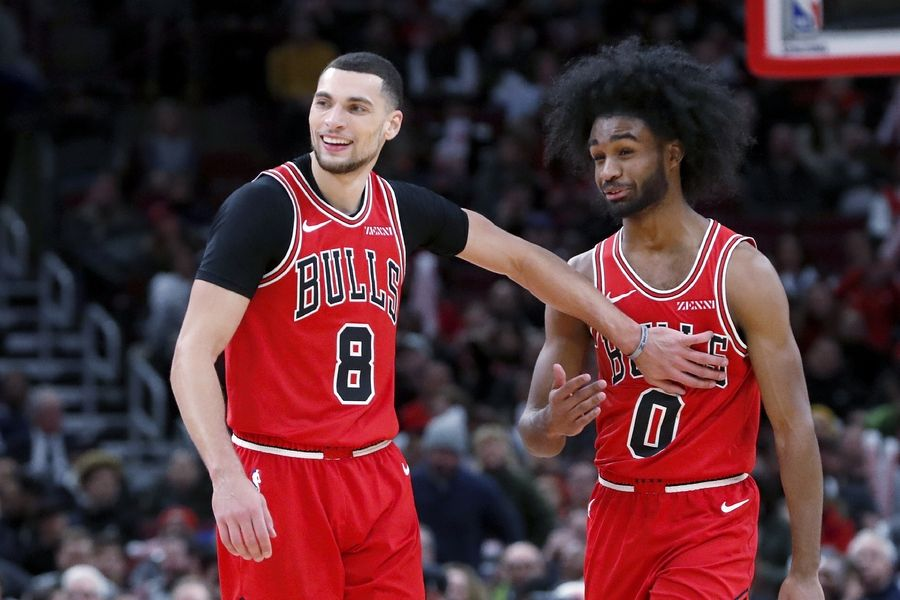 Chicago Bulls' Zach LaVine (8) acknowledges the play of first-round draft pick Coby White during the second half of an NBA basketball game against the New York Knicks Tuesday, Nov. 12, 2019, in Chicago. The Bulls won 120-102.