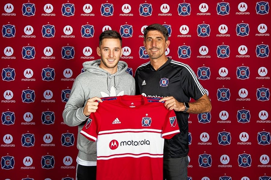 New Chicago Fire midfielder Alvaro Medran, left, poses with then coach Veljko Paunovic when Medran signed in October. Paunovic and his staff were fired Wednesday.