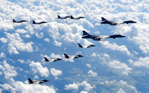 "FILE - In this Sept. 18, 2017, file photo provided by South Korea Defense Ministry, U.S. Air Force B-1B bombers, F-35B stealth fighter jets and South Korean F-15K fighter jets fly over the Korean Peninsula during joint drills. North Korea's supreme decision-making body on Wednesday, Nov. 13, 2019, has lashed out at planned U.S.-South Korean military drills and warned that the United States will face a ""bigger threat and harsh suffering"" if it ignores North Korean leader Kim Jong Un's end-of-year deadline to salvage nuclear talks. (South Korea Defense Ministry via AP, File)"