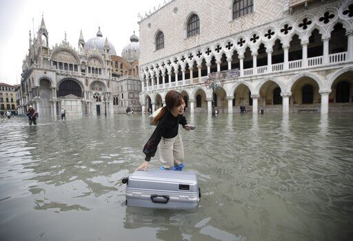 Venice flooding nearly touches level of infamous 1966 flood