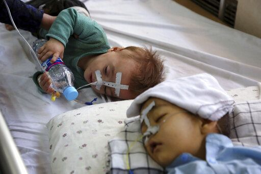 In this Oct. 15, 2019 photo, Afghan children receive treatment for respiratory problems at a pediatric hospital, in Kabul, Afghanistan. Afghanistan's authorities are trying to tackle pollution in the country's capital, which may be even deadlier than 18-year-old war. The research group State of Global Air said more than 26,000 deaths could be attributed to air pollution in 2017, compared to 3,483 civilians killed that year in the Afghan war.