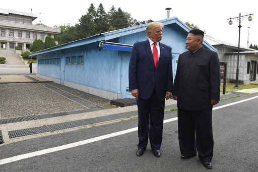 FILE - In this June 30, 2019, file photo, U.S. President Donald Trump, left, meets with North Korean leader Kim Jong Un at the border village of Panmunjom in Demilitarized Zone, South Korea. North Korea on Thursday, Nov. 14, says the United States has proposed a resumption of stalled nuclear negotiations in December as they approach an end-of-year deadline set by North Korean leader Kim Jong Un for the Trump administration to offer an acceptable deal to salvage the diplomacy.