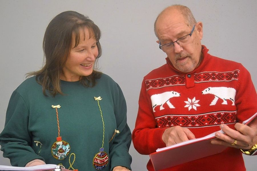 "Peggy Lyons, left, and Rick Johnson appear in the Elgin Theatre Company production of ""An Elgin Old Tyme Holiday Radio Show 3."" The recreation of three classic radio broadcasts will take place Nov. 15-24 at the Elgin Art Showcase."