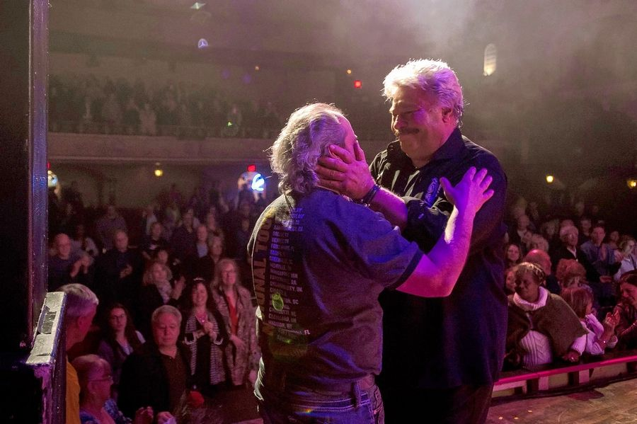 Tony Orlando, right, warmly welcomes Arcade Theatre owner Ron Onesti during his show in St. Charles Sunday, Nov. 10.