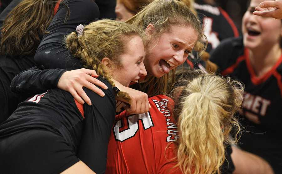 Benet Academy's Caroline Doyle sticks out her tongue as the Redwings celebrate their win against Marist in the Class 4A girls volleyball state semifinal match at Illinois State University in Normal Friday, Nov. 15, 2019.