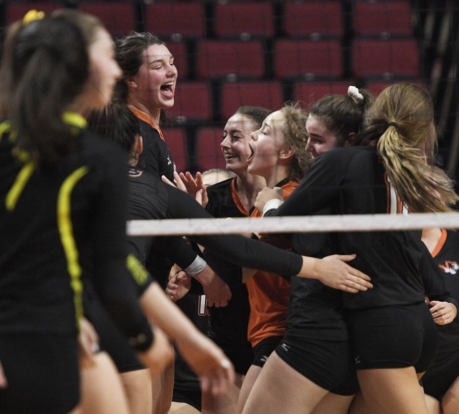 Wheaton Warrenville South celebrates its win against Fremd in the Class 4A girls volleyball state semifinal match at Illinois State University in Normal Friday.