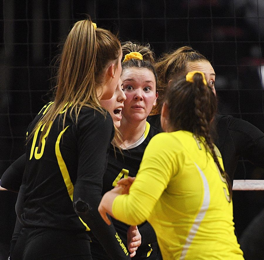 Fremd's Breslen Reid and teammates look for answers against Wheaton Warrenville South in the Class 4A girls volleyball state semifinal match at Illinois State University in Normal Friday.