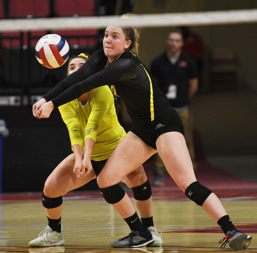 Fremd's Breslen Reid defends a serve with teammate Izzy Segoviano against Wheaton Warrenville South in the Class 4A girls volleyball state semifinal match at Illinois State University in Normal Friday.