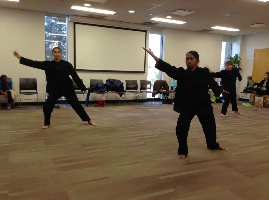 Performers from the Arlington Heights School of Martial Arts give a tai chi demonstration Saturday in the Cardinal Room of the Arlington Heights Memorial Library.