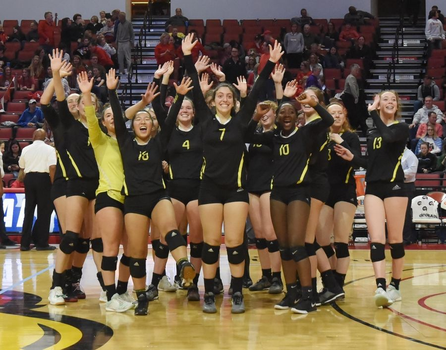 Fremd players wave to their families after losing to Marist in the Class 4A girls volleyball state third place match at Illinois State University in Normal Saturday.