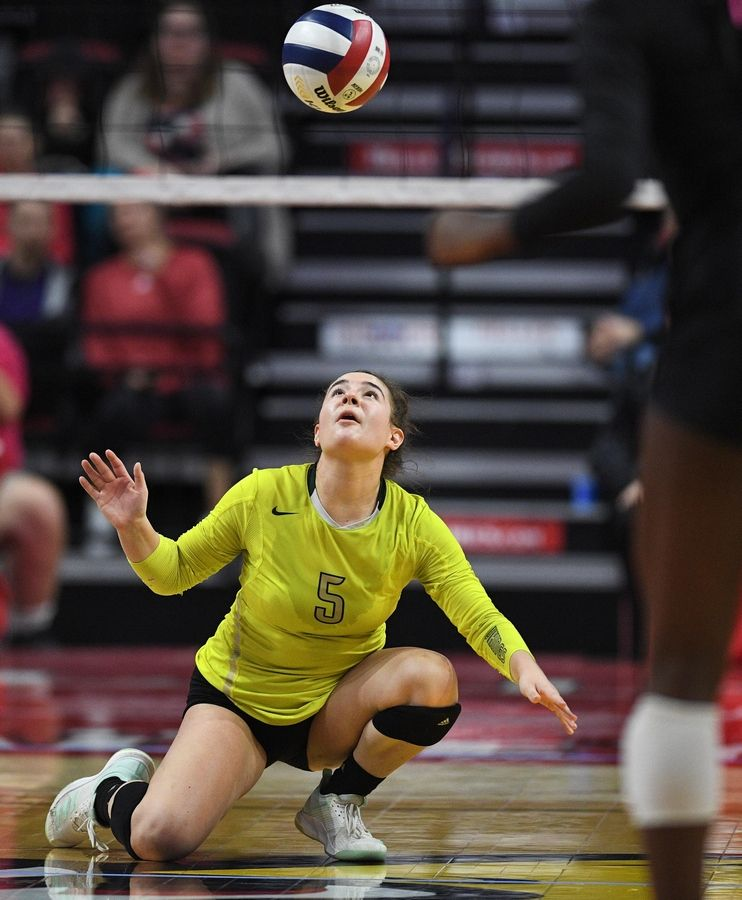 Fremd's Izzy Segoviano tries to control a Marist shot in the Class 4A girls volleyball state third place match at Illinois State University in Normal Saturday.