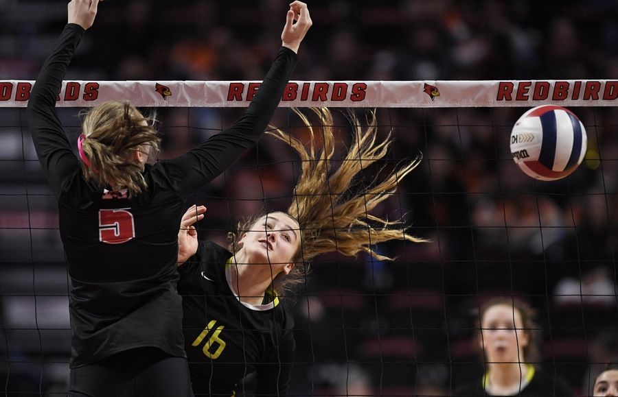 Fremd's Claudia Wala scores against Marist's Mary Clare Brusek in the Class 4A girls volleyball state third place match at Illinois State University in Normal Saturday.