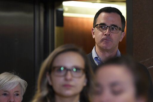 Tim Morrison, the top Russia official on President Trump's National Security Council, gets off of an elevator as he returns to Capitol Hill in Washington, Wednesday, Nov. 6, 2019, to review his testimony before the House impeachment inquiry last week.