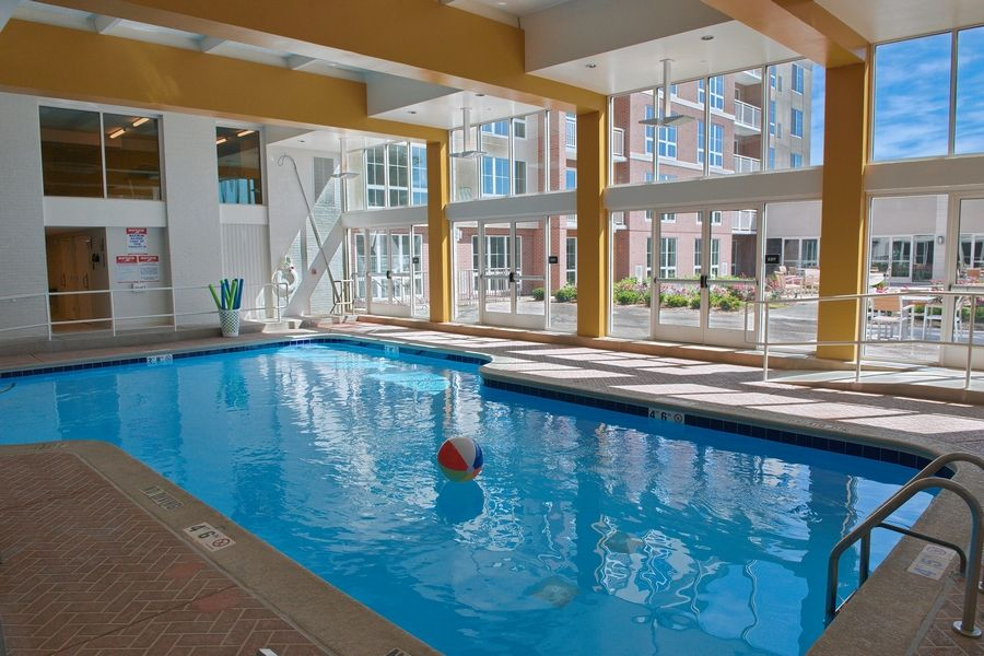 The indoor pool at The Grand at Twin Lakes overlooks the courtyard and is used for group exercise classes, and it is also popular with visiting grandchildren of residents.