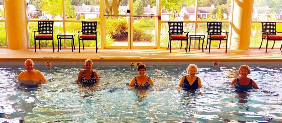 Keeping your mind and body active is the secret to good health and happiness as you age. These residents of The Moorings in Arlington Heights are exercising in a water aerobics class held in the community's indoor swimming pool.