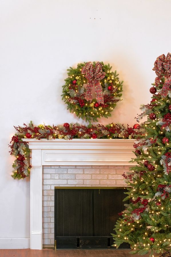 Treetime's Wexford wreaths and garlands help create that traditional fireplace look to celebrate the holidays.