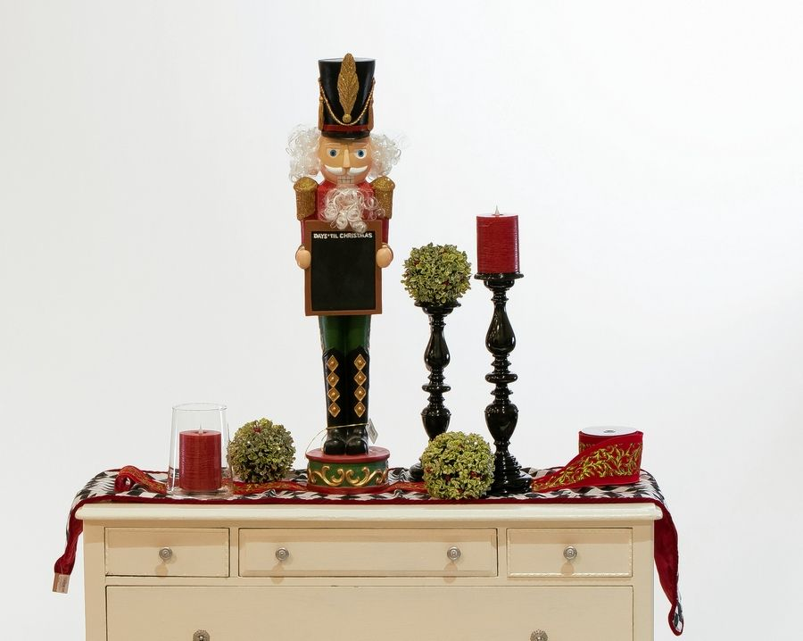 This traditional Christmas nutcracker sets the stage for a fireplace mantel.