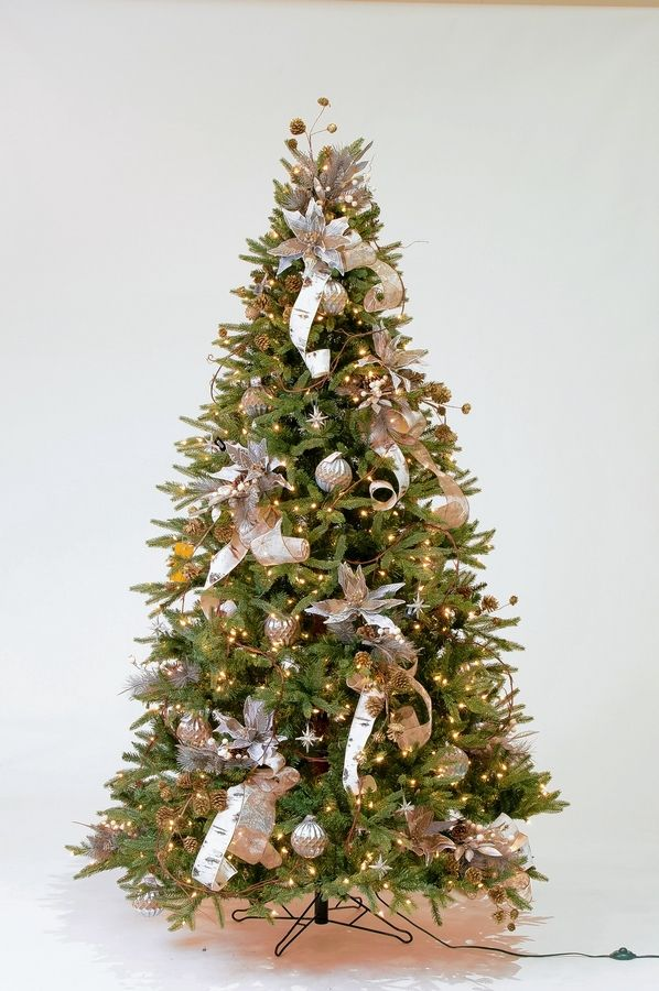 Treetime's Stockton Spruce artificial Christmas tree will bring this living room to life.