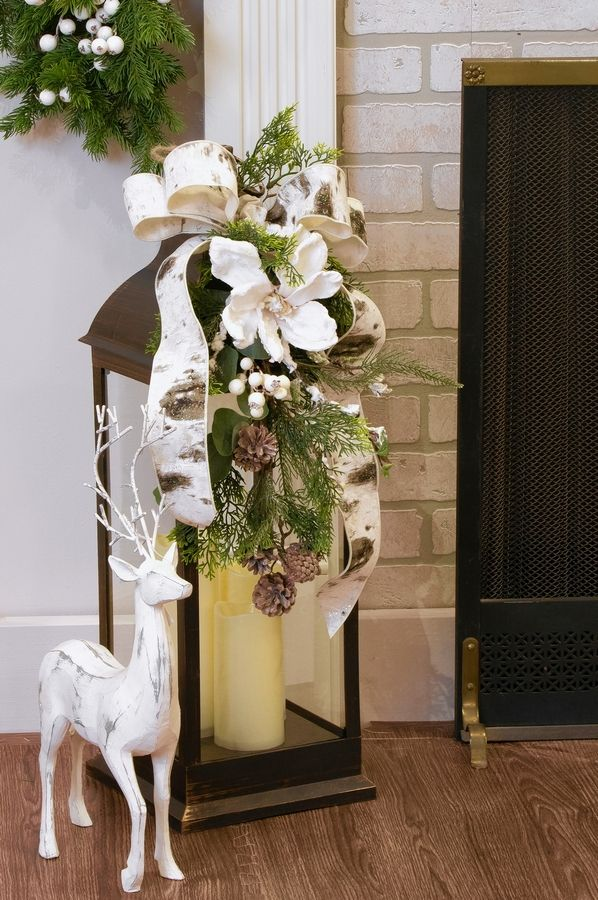 This lantern decorated with ribbons and florals adds an elegant touch to the holidays.