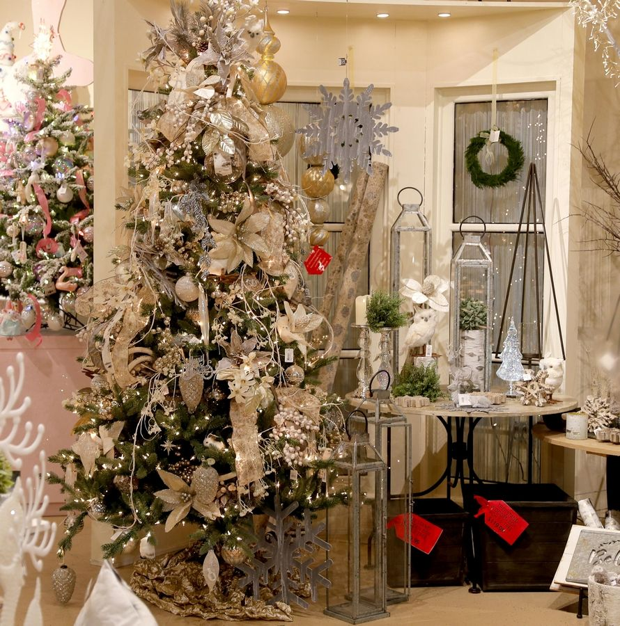 Gray, white and beige ornaments decorate the Modern Farmhouse tree. Natural branches decorate the table next to the tree.
