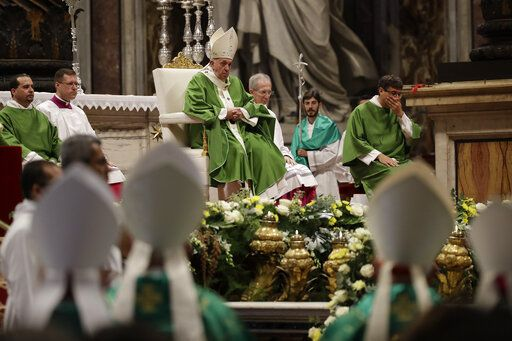 Pope Francis celebrates a Mass in St. Peter Basilica at the Vatican, Sunday, Nov. 17, 2019. Pope Francis is offering several hundred poor people, homeless, migrants, unemployed a lunch on Sunday as he celebrates the World Day of the Poor with a concrete gesture of charity in the spirit of his namesake, St. Francis of Assisi.