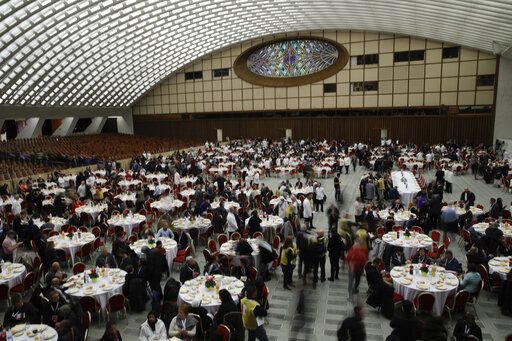 People wait for Pope Francis arrival for a lunch in the Paul VI Hall at the Vatican, Sunday, Nov. 17, 2019. Pope Francis is offering several hundred poor people, homeless, migrants, unemployed a lunch on Sunday as he celebrates the World Day of the Poor with a concrete gesture of charity in the spirit of his namesake, St. Francis of Assisi.