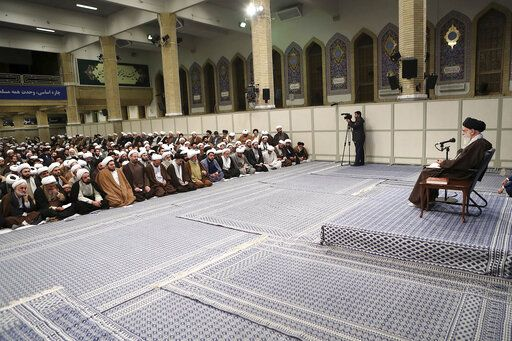 "In this photo released by the official website of the office of the Iranian supreme leader, Supreme Leader Ayatollah Ali Khamenei, right, talks to clerics in his Islamic thoughts class in Tehran, Iran, Sunday, Nov. 17, 2019. Iran's supreme leader supported the government's decision to increase gasoline prices and says that those setting fire to public property during protests against the hikes are ""bandits"" backed by the enemies of Iran. (Office of the Iranian Supreme Leader via AP)"