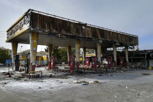 "This photo released by the Iranian Students' News Agency, ISNA, shows a gas station that was burned during protests that followed authorities' decision to raise gasoline prices, in Tehran, Iran, Sunday, Nov. 17, 2019.  Ayatollah Ali Khamenei, Iran's supreme leader on Sunday backed the government's decision to raise gasoline prices and called angry protesters who have been setting fire to public property over the hike ""thugs,"" signaling a potential crackdown on the demonstrations. (Abdolvahed Mirzazadeh/ISNA via AP)"